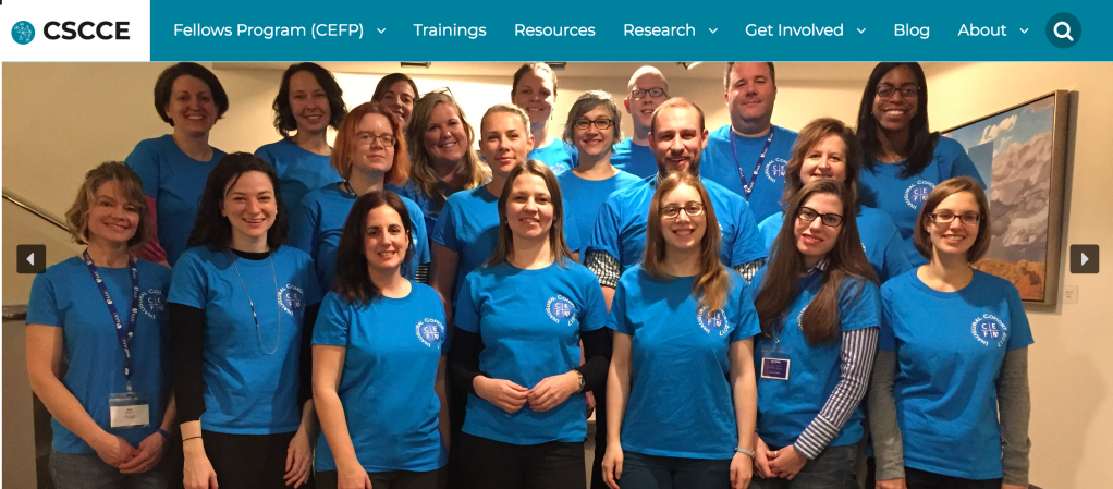 Group photo of 20 smiling people in blue tshirts, all 2017 community engagement program fellows.